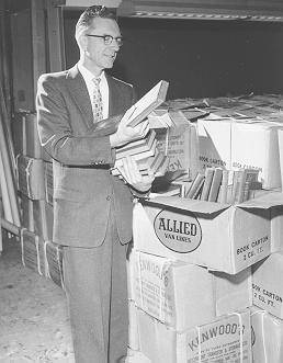 University Librarian Neal Harlow with Thomas Murray Collection, 1958