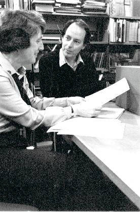 Bill New and Anne Yandel look over Malcolm Lowry papers purchased by the library, 1984.