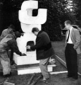 "Robert Clothier installing ""Three Forms"" sculpture"