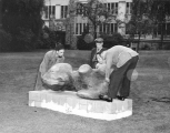 "Robert Clothier oversees the installation of ""Reclining Figure"" sculpture"